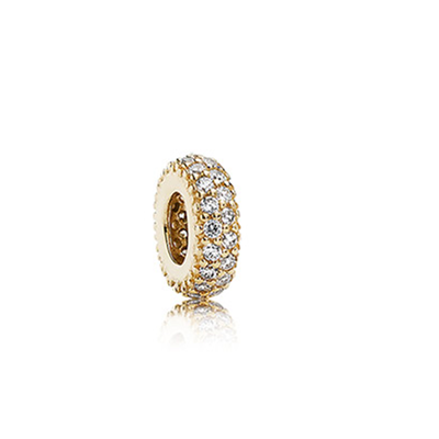 Abstract gold spacer with cubic zirconia